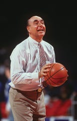 Basketball commentator Dick Vitale looked to shoot a free throw prior to a 77-52 Georgetown win over Villanova in February 1995.