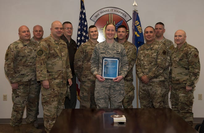 Airman 1st Class Emily H. Pizzello, 49th Contracting Squadron contract administrator and representatives from the Holloman Air Force Base's Chiefs Group pose with during a group photo Jan 21, 2019, on Holloman Air Force Base, N.M. Holloman's Chiefs Group has a monthly recognition program titled Chief's Choice Award, and every month a chief has the honor of choosing a deserving Airman for an outstanding act or for continuous outstanding performance.