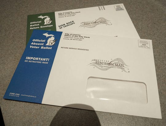 The new look of absentee ballot envelopes that will arrive in the mail for those who request them, top, and the envelopes they'll return their ballots in, at rear.