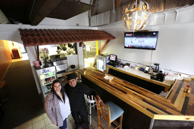Anika and Sergio Guerrero pose for a photo Wednesday, Jan. 15, 2020, in front of the bar at their restaurant, Takiza Mexican Cuisine, 242 Wisconsin St., Oshkosh.