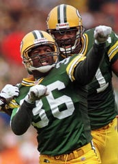 Green Bay Packer safety LeRoy Butler celebrates with defensive tackle Santana Dotson after sacking Tampa Bay quarterback Trent Dilfer during a game in 1996.