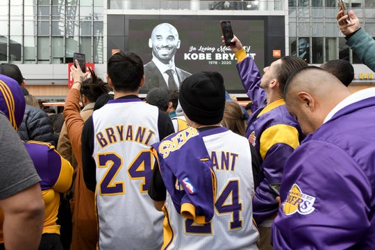 People gather outside Staples Center after the death of Laker legend Kobe Bryant, Sunday, Jan. 26, 2020, in Los Angeles. (AP Photo/Michael Owen Baker)