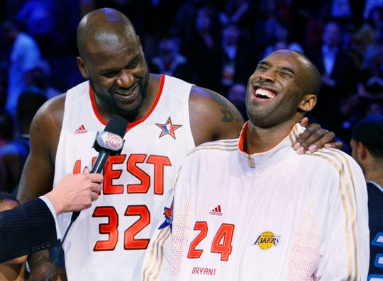 157327 allstarsat0215 -- 02/15/2009  -- West All-Star Shaquille O'Neal and Kobe Bryant (cq) smile after winning the MVP award at the NBA All-Star Game at US Airways Center in Phoenix, AZ.  (Rob Schumacher/The Arizona Republic)