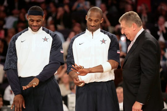 Lebron James (left) and Kobe Bryant show off their Olympic rings after receiving them from Jerry Colangelo during a haltime ceremony in the NBA All Star Game at U.S. Airways Center in Phoenix Feb. 15, 2009.