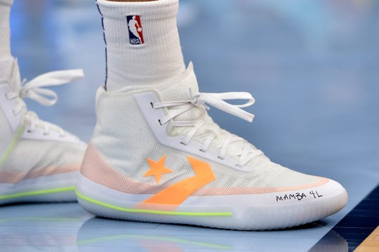 Phoenix Suns forward Kelly Oubre Jr. wears shoes with a tribute message to the late Kobe Bryant in the first half of an NBA basketball game against the Memphis Grizzlies, Sunday, Jan. 26, 2020, in Memphis, Tenn. (AP Photo/Brandon Dill)