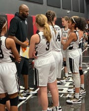 Kobe Bryant speaks to his youth girls basketball team Mamba Sports Academy with his daughter Gianna Bryant (far right) at the PHHacility in Phoenix.