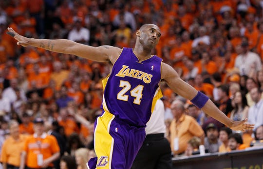 Los Angeles Lakers' Kobe Bryant soars back to the bench after hitting a basket to hold off the Phoenix Suns during Game 6 of the NBA Western Conference finals at US Airways Center in Phoenix, AZ in 2010.