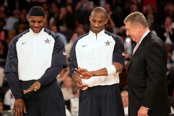 Lebron James (left) and Kobe Bryant show off their Olympic rings after receiving them from Jerry Colangelo during a halftime ceremony in the NBA All Star Game at U.S. Airways Center in Phoenix February 15, 2009.    photo by Michael Chow/The Arizona Republic