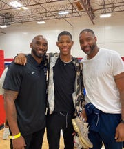Kobe Bryant, with HIllcrest guard Dalen Terry and former NBA player Tracy McGrady, during a visit to the Valley.