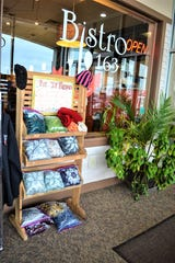 Locals in need can pick up a free arm scarf at the stand outside Bistro 163 in the Sutton Center building in Port Clinton.
