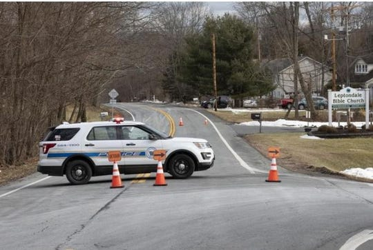 Town of Newburgh police block off Route 300 at Chapel Road. It was closed for hours on Sunday as police investigated an early morning shooting that left a mother, father and their 9-year-old son dead and 3-year-old son seriously injured.
