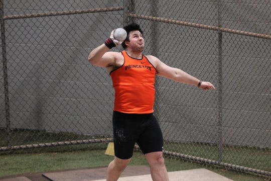 Kelton Chastulik fires the shotput for Princeton.