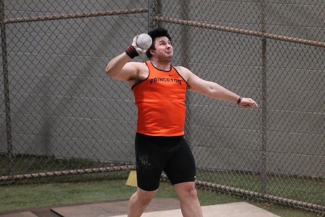 Kelton Chastulik fires the shotput for Princeton.