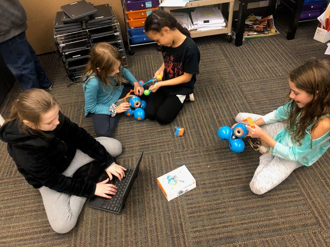 Third graders Jassidy Pownall-Toledo, 9; Ava O'Connor, 9; Layla Riker, 8, and Isabelle Resch, 9, work on computer science activities in Southern York County School District. The district will be one of four in the county to initiate Computer Science for All -- a unit that would integrate computer science with several subjects including math and language arts, in the spring of 2020.