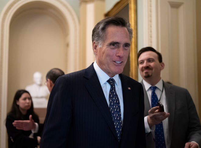 Sen. Mitt Romney, R-Utah, arrives at the Senate for a Republican lunch before work resumes in the impeachment trial of President Donald Trump on charges of abuse of power and obstruction of Congress, in Washington, Friday, Jan. 24, 2020. (AP Photo/J. Scott Applewhite)