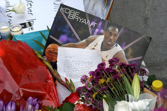 A memorial for Kobe Bryant near Staples Center after the death of Laker legend Kobe Bryant Sunday, Jan. 26, 2020, in Los Angeles. (AP Photo/Michael Owen Baker)