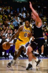 York resident Mark Hendrickson competes against Kobe Bryant while a member of the Sacramento Kings in 1998. Hendrickson has a signed portrait of this picture hanging in his office.