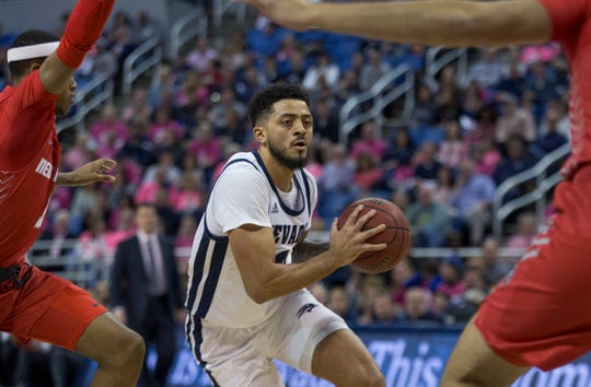 Nevada guard Jalen Harris (2) drives past the New Mexico defense during the first half of a basketball game played at Lawlor Events Center in Reno, Nev., Saturday, Jan. 25, 2020.