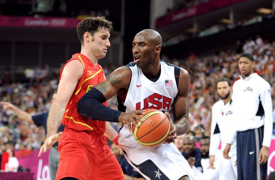 Kobe Bryant of the United States takes the ball up against Rudy Fernandez of Spain during the Men's Basketball gold medal game between the United States and Spain on Day 16 of the London 2012 Olympics Games at North Greenwich Arena on August 12, 2012 in London, England.