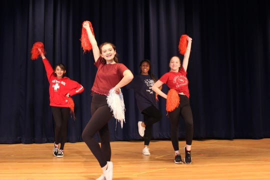 "From left, Gracie Conn, Sophie Hilger, Jordyn Chalmers and Lily Fitzpatrick strike a pose during rehearsal for Brighton High School's production of ""High School Musical,"" which will be presented Feb. 27 to 29 at French Road Elementary School."