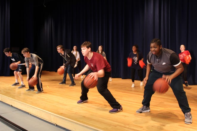 """From left, Colin Quattrini (in red) and Chad Asante do some fancy dribbling during dance rehearsals for Brighton High School's upcoming production of """"High School Musical,"""" scheduled for Feb. 27 to 29 at French Road Elementary School."""