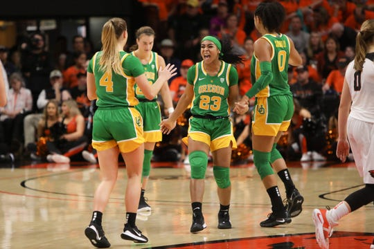 Oregon's Minyon Moore (23) celebrates with Jaz Shelley (4), Sabrina Ionescu (20) and Satou Sabally (0) following Oregon's victory over Oregon State in an NCAA college basketball game in Corvallis, Ore., Jan. 26, 2020.