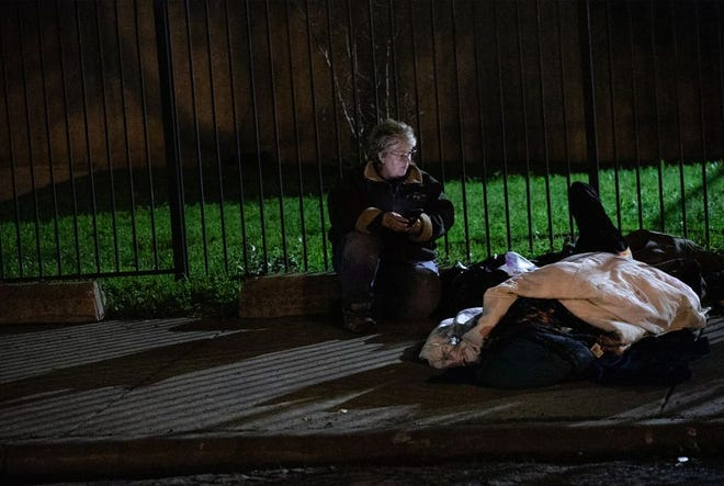 Daneille Tooker canvassed encampments in Dallas near Malcom X Boulevard and Interstate 30 on Thursday. The Point in Time Count attempts to capture data about homelessness through an interview with and observation of each individual.