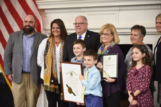 Gov. Larry Hogan presents an official citation to Sharon Upton and family of Jeptha Hayman Farm of Westover on Jan. 27 during the 2020 Century Farm ceremony at the State House in Annapolis. From left are:  Josh Upton, Rachel Goloboski, Gov. Larry Hogan, Braedon Goloboski, Cooper Goloboski, Sharon Upton (owner), Debbie Bailey, Harper Goloboski and Deputy Secretary of Agriculture Julie Oberg.