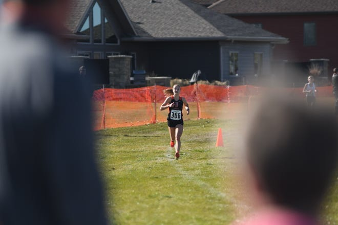 Lennox's Ali Bainbridge competes at the 2019 Class A state cross country meet in Huron.
