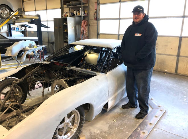 Scott Taylor stands next to his 1998 Firebird, named Track Doe, before the paint job by CV Kustomz was complete.