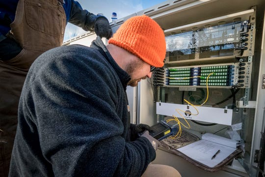 Contract Fiber Optic Technician Nathan Roten tests the fiber connection at one of Virginia's BARC Electric Cooperative's substation patch panels.