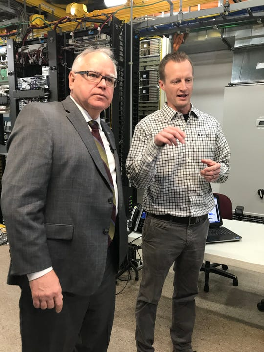 Gov. Tim Walz (left) listens to Arvig Engineering Manager Brett Christiansen at Arvig's central office in Melrose, on Monday, Jan. 27, 2020.