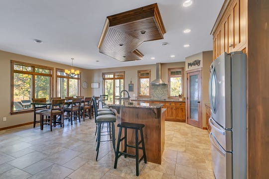 The eat-in kitchen is spacious with plenty of seating space for friends, family and entertaining.