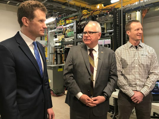 DEED Commissioner Steve Grove (left), Gov. Tim Walz, and Arvig Engineering Manager Brett Christiansen tour Arvig's central office in Melrose, on Monday, Jan. 27, 2020.