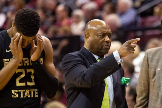 Florida State head coach Leonard Hamilton, right, calls up a player to replace injured guard M.J. Walker (23) in the first half of an NCAA college basketball game against Notre Dame in Tallahassee, Fla., Saturday, Jan. 25, 2020. (AP Photo/Mark Wallheiser)