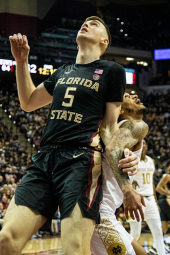 Florida State center Balsa Koprivica (5)and Notre Dame guard Prentiss Hubb (3) get tangled up waiting on a rebound in the second half of an NCAA college basketball game in Tallahassee, Fla., Saturday, Jan. 25, 2020. (AP Photo/Mark Wallheiser)