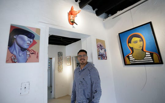 Diego Martinez, El Paso artist and co-owner of Galeria Lincoln, gives a tour of the new gallery at 3915 Rosa Ave.