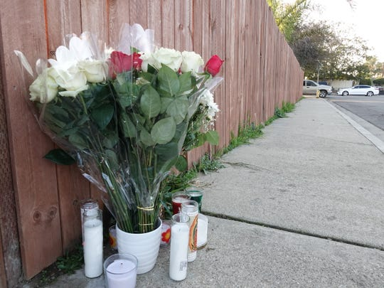 Flowers and candles were visible on the sidewalk in the 3200 block of Sycamore Street in Oxnard on the afternoon of Jan. 26, 2020, near where a man died of stab wounds around 12:40 a.m.