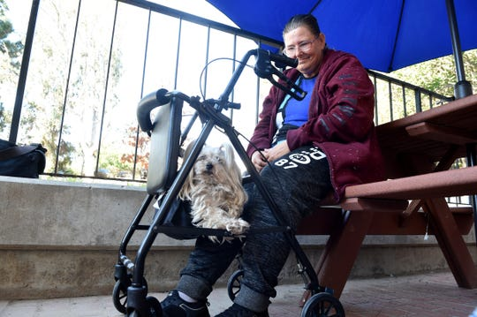 Wendy Rasmussen, 54, sits with her dog after attending the grand opening ceremony of The ARCH homeless shelter on Monday, Jan. 27, 2020, in Ventura. Rasmussen, who has been living in her car for three years, is hoping to be one of the first new clients at the shelter.