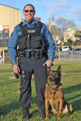 Millville Police are mourning the loss of K-9  Chase, pictured here with his partner Officer Michael Calchi on Dec. 18, 2014.  File photo