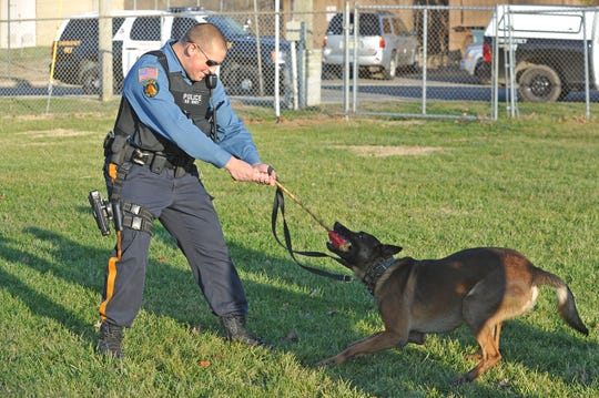 """Millville K-9 officer Michael Calchi with partner """"Chase"""". Dec. 18, 2014. Staff photo"""