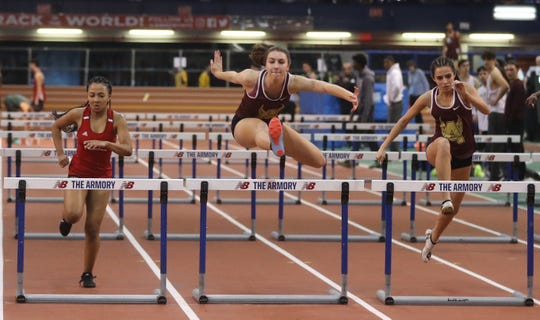 Cassandra Coster of Arlington, center, won the 55 meter hurdles for the Northern Counties during the Rockland and Northern Counties indoor track & field championships were held at the New Balance Armory in Manhattan Jan. 26, 2020.