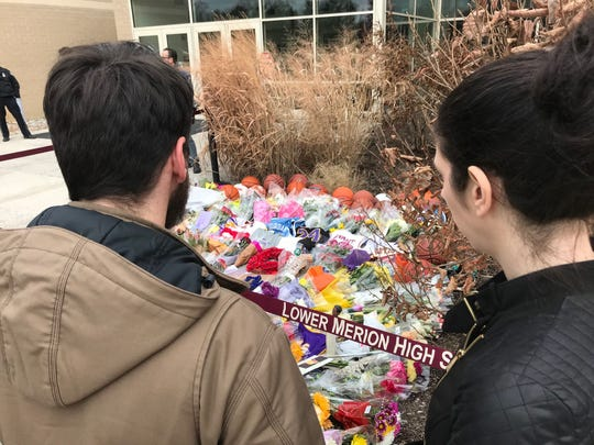 People continued to visit Lower Merion High School Monday.  A shrine of flowers, basketballs, sneakers and other items were left to mourn the sudden death of Kobe Bryant.