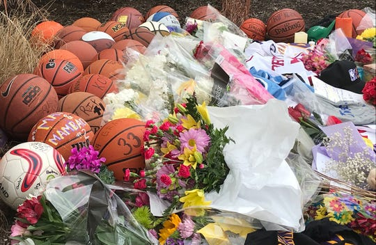 Items left near the gymnasium at Lower Merion High School named after Kobe Bryant.