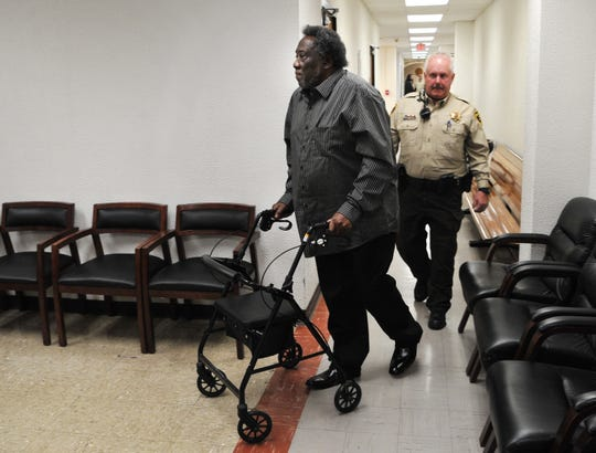 A Wichita County sheriff's deputy walks Robert Fleeks from 78th District Court back to Wichita County Jail on Monday morning. Fleeks is on trial for two firearms offenses.