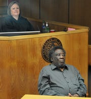 Seventy-eighth District Judge Meredith Kennedy, top, and defendant Robert Fleeks, as shown in this Jan. 27, 2020, file photo, listen as the prosecution questions potential members of a jury that could decide Fleeks' fate during his upcoming trial.