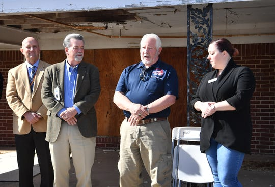 Steve Halloway, center, board chair for Base Camp Lindsey, talks about future plans to help homeless veterans at the organization's newly acquired property at 1908 Sixth Street.