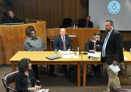 Wichita County Chief Felony Prosecutor Dobie Kosub, far right, questions a potential jury member on Monday during the jury selection portion of the Robert Fleeks' firearm trial. A murder charge against Fleeks in connection with the 2016 death of a Wichita Falls woman was dropped Monday ahead of the trial. Fleeks, far left, defense attorney Brian Walker of Fort Worth, second from left, and Assistant District Attorney Joe Cole, second from right, listen to proceedings.