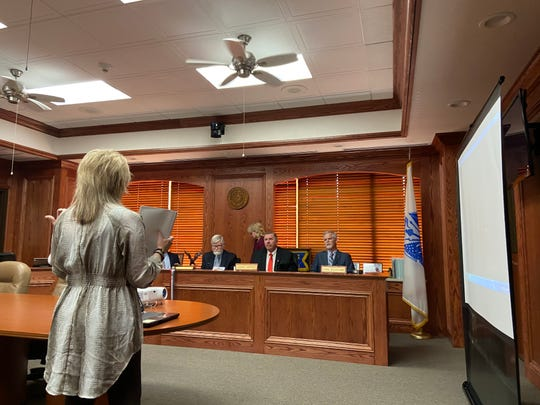 Lisa Lothenore, head of Home for Freedom, speaks with the Wichita County Commissioners Monday about her plans for improvements to the Wichita County Cemetery.