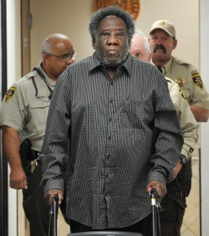 Wichita County deputies walk Robert Fleeks from the 78 District Courtroom back to Wichita County Jail on Monday morning. Fleeks was charged with murder in connection with the June 16, 2016, death of Helen Lawshawn Darlene Fletcher, 30. The murder charge was dismissed Monday. Fleeks will be tried this week on firearms charges.